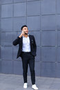 Handsome arabic man talks on smart phone in business center Royalty Free Stock Photo