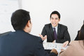 Handsome Asian businessman sharing opinion at the meeting Royalty Free Stock Photo