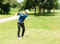 Handsome asian golfers man putt golf on green Stock Photos