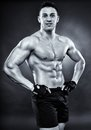 Handsome athletic man standing akimbo monochrome shot of Stock Images