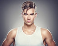 Handsome athletic young man isolated on grey background Stock Images