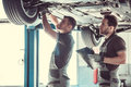 Handsome auto service workers Royalty Free Stock Photo