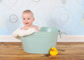 Handsome baby boy sitting in washtub Stock Images