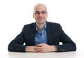 Handsome bald man sitting at the desk Royalty Free Stock Photo