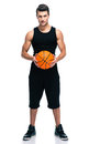 Handsome basketball player with ball Royalty Free Stock Photo