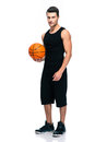 Handsome basketball player standing isolated Royalty Free Stock Photo