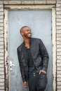 Handsome black man laughing outdoors portrait of a Royalty Free Stock Photos