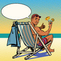Handsome black man resting on the beach Royalty Free Stock Photo