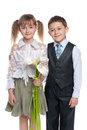 Handsome boy and pretty girl with flowers a a are standing together on the white background Royalty Free Stock Image
