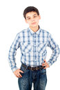Handsome boy in a shirt stands isolated Stock Image