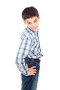 Handsome boy in a shirt stands isolated on white background Royalty Free Stock Photo