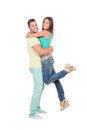Handsome boyfriend lifting his girlfriend in his arms isolated on a white background Stock Photography
