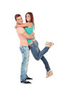 Handsome boyfriend lifting his girlfriend in his arms on a white background Royalty Free Stock Image