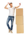 Handsome builder with big boxes picture of Stock Photos