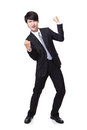 Handsome business man with arms raised in success Stock Image