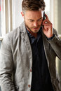 Handsome business man having serious telephone conversation Royalty Free Stock Photo