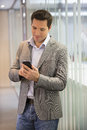 Handsome Business man at the office on phone, sms, e-mail Royalty Free Stock Photo
