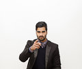 Handsome business man pointing on white background Stock Image