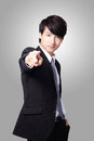 Handsome business man pointing at you Stock Photography