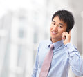 Handsome business man speaking mobile phone Royalty Free Stock Photo