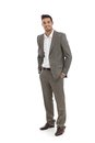 Handsome businessman in grey suit standing hands pocket Stock Photography