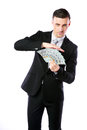 Handsome businessman holding us dollars isolated on a white background Stock Photography