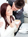 Handsome businessman kissing his girlfriend Royalty Free Stock Photos