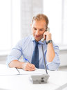 Handsome businessman talking on the phone picture of Royalty Free Stock Image