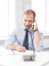 Handsome businessman talking on the phone picture of Royalty Free Stock Images
