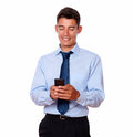 Handsome businessman texting on his cellphone portrait of a while standing white background Royalty Free Stock Image