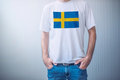 Handsome casual man wearing white t-shirt with Swedish flag Royalty Free Stock Photo