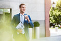 Handsome cheerful man standing near office building Royalty Free Stock Photo