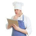 Handsome chef cook using tablet pc. Royalty Free Stock Photos
