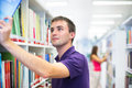 Handsome college student in library Royalty Free Stock Images