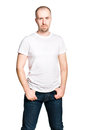 Handsome confident man in white t shirt vertical portrait of a and blue jeans isolated on Stock Photos