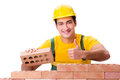 The handsome construction worker building brick wall Royalty Free Stock Photo