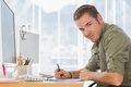 Handsome creative business employee working in a modern office Royalty Free Stock Photography