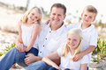 Handsome Dad and His Cute Children at The Beach Royalty Free Stock Photo