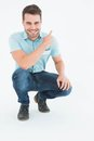 Handsome delivery man pointing backward Royalty Free Stock Photo