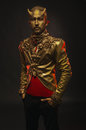 Handsome devil man with golden horns Royalty Free Stock Photo