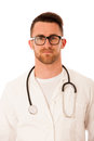 Handsome doctor in white robe with stethoscope around neck. Royalty Free Stock Photo