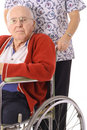 Handsome elderly man in wheelchair with nurse Royalty Free Stock Images