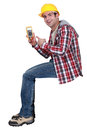 Handsome electrician pointing at tester young Royalty Free Stock Photos