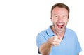 Handsome excited man happy smile with blue shirt pointing finger towards at you to the camera gesture closeup portrait of and Royalty Free Stock Photography