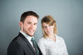 Handsome executive business man with female coworker young men Royalty Free Stock Image