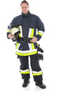 Handsome fireman in his uniform and gear high visibility with including helmet gloves fire axe posing on white Stock Photo