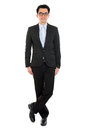 Handsome full body asian business man in formal suit standing isolated on white background Royalty Free Stock Photos