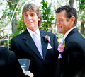 Handsome gay couple getting married outdoor ceremony Royalty Free Stock Images