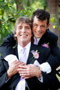 Handsome gay couple wedding portrait in love posing for an outdoor Royalty Free Stock Photos