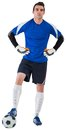 Handsome goalkeeper in blue jersey on white background Stock Photo